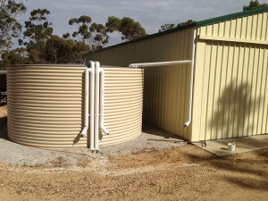 Rainwater tank next to shed in limited space – Custom made large tank for water storage